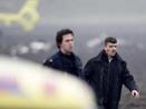 2名受伤的机上人员,脸上露出血迹